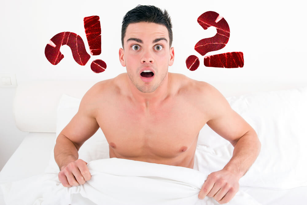 Surprised And Shocked Half Naked Young Man In Bed