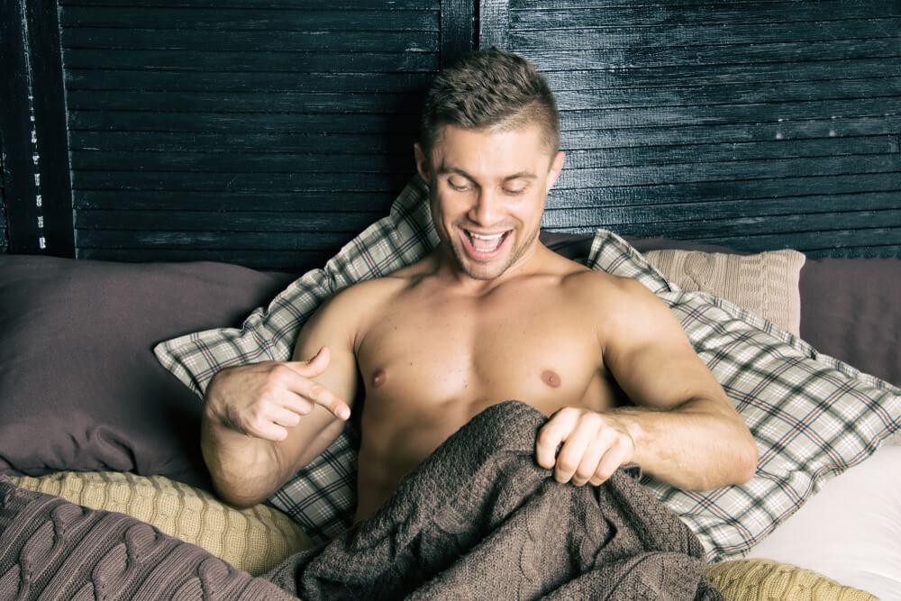 Happy Guy in Bed Before Masturbating